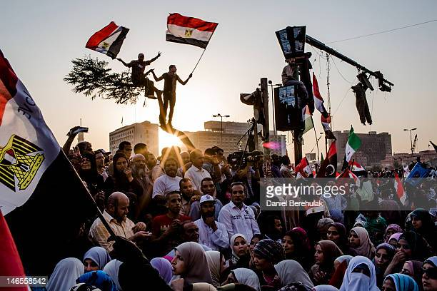 Egyptians supporters of the Muslim Brotherhood celebrate a premature victory for their presidential candidate Mohamed Morsi in Tahrir Square on June...