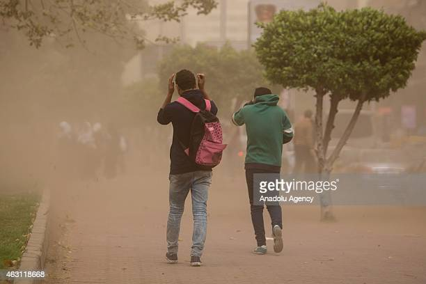 Egyptians try to walk through in a sandstorm Cairo Egypt on February 10 2015