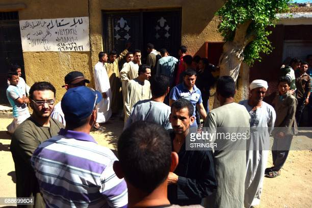 Egyptians wait outside a hospital to retreive some of the bodies of the victims of an attack in which 28 Coptic pilgirms were gunned down following a...