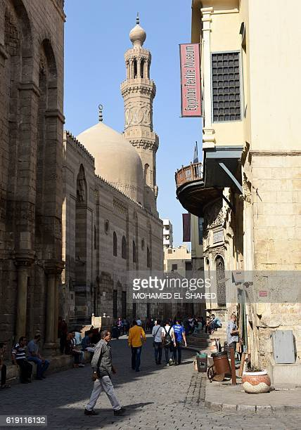 Egyptians walk in the tourist area of AlHussein in the capital Cairo on October 24 2016 A year after jihadists bombed a Russian plane carrying...