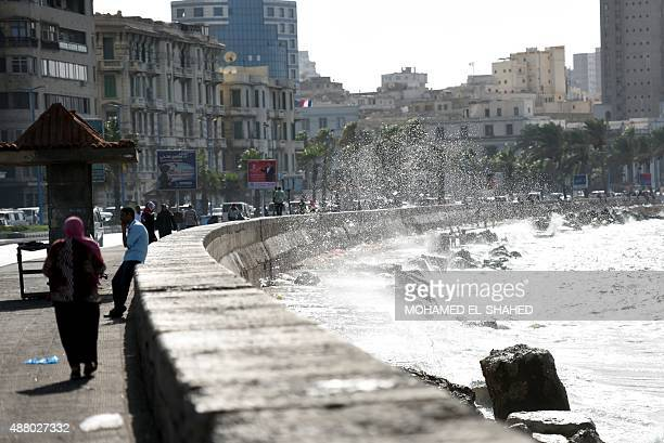 Egyptians walk on the Corniche seaside promenade on September 12 2015 in the Egyptian port city of Alexandria AFP PHOTO / MOHAMED ELSHAHED