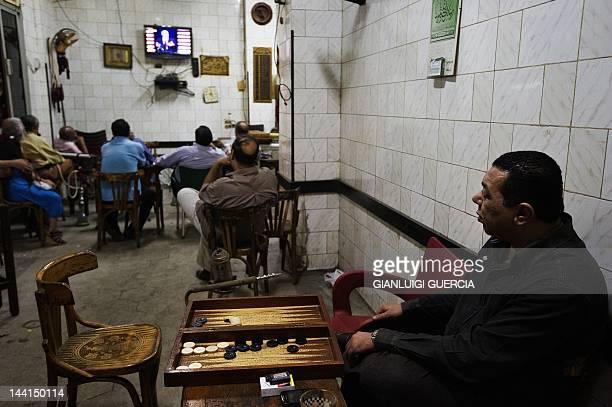 Egyptians watch presidential hopeful candidate moderate Islamist Abdelmoneim Abul Fotouh and former Arab League General Secretary Amr Mussa speaking...