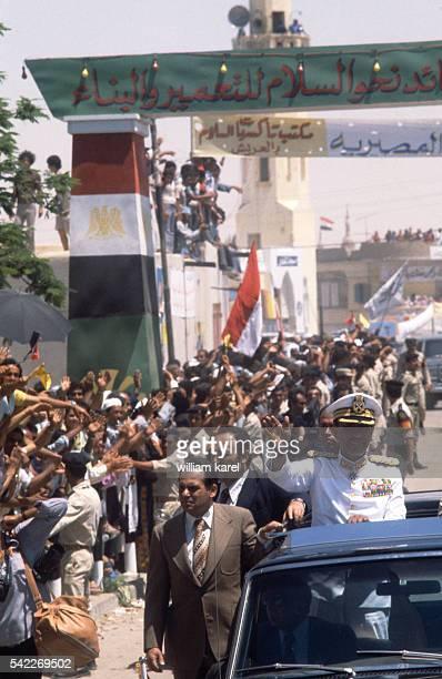 Egyptians welcome the arrival of Egyptian President Anwar al-Sadat in El Arish after Israel hands back El Arish to Egypt.