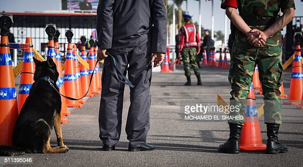 Egyptin secuity forces stand guard outside the Conference Hall in the Red Sea resort of Sharm elSheikh during the Africa 2016 forum on February 20...