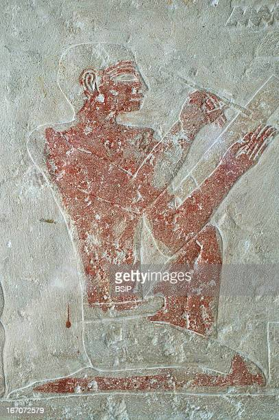 Egyptology Bas relief at the Egyptian Museum in Cairo depicting a scribe