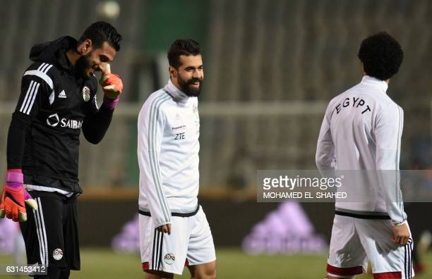 Egypt's Abdallah Said and Goalkeaper Ahmed ElShenawy take part in a training session of Egypt's national team on January 8 2017 at the Cairo...