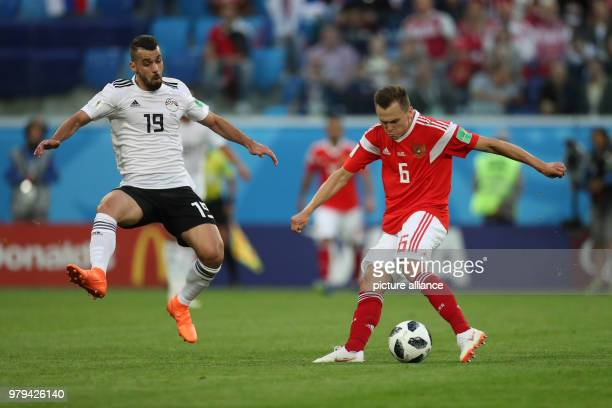 Egypt's Abdallah Said and Russia's Denis Cheryshev in action during the FIFA World Cup 2018 Group A soccer match between Egypt and Russia at the...