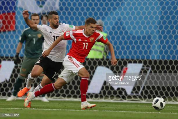 Egypt's Abdallah Said and Russia's Roman Zobnin vie for the ball during the FIFA World Cup 2018 Group A soccer match between Egypt and Russia at the...