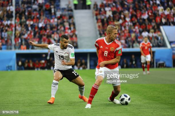 Egypt's Abdallah Said and Russia's Yury Gazinsky vie for the ball during the FIFA World Cup 2018 Group A soccer match between Egypt and Russia at the...