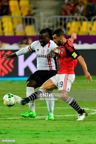 Egypts Abdallah Said challenges Ugandas Hassan Wasswa for the ball during the FIFA World Cup 2018 qualification football match between Egypt and...