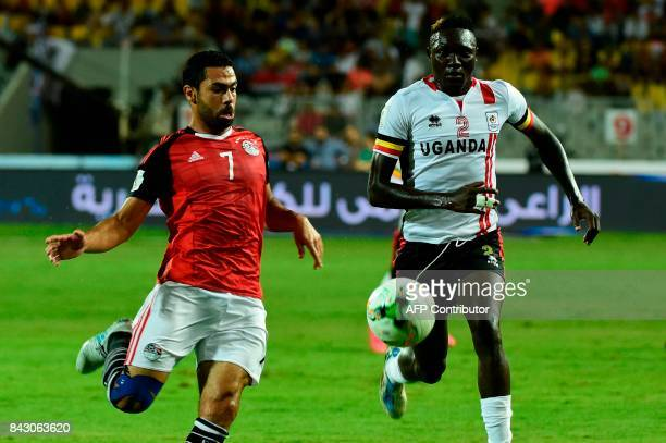 Egypts Ahmed Fathy challenges Ugandas Emmanuel Okwi for the ball during the FIFA World Cup 2018 qualification football match between Egypt and Uganda...