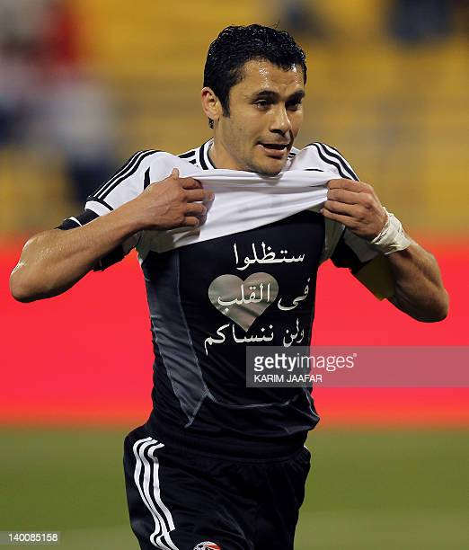 Egypt's Ahmed Hassan celebrates after scoring a goal against Kenya during a friendly football match in the Qatari capital Doha on February 27, 2012...