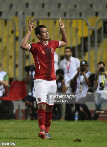 Egypt's Al Ahly footballer Amr Gamal celebrates his goal against Cameroon's Cotonsport during their African Champions League group stage football...