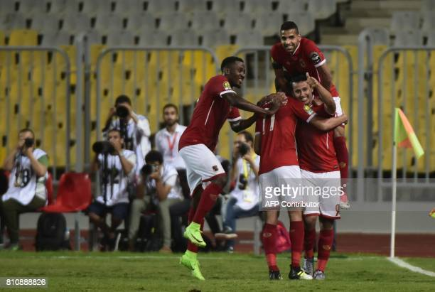 Egypt's Al Ahly footballer Amr Gamal celebrates with teammates his goal against Cameroon's Cotonsport during their African Champions League group...