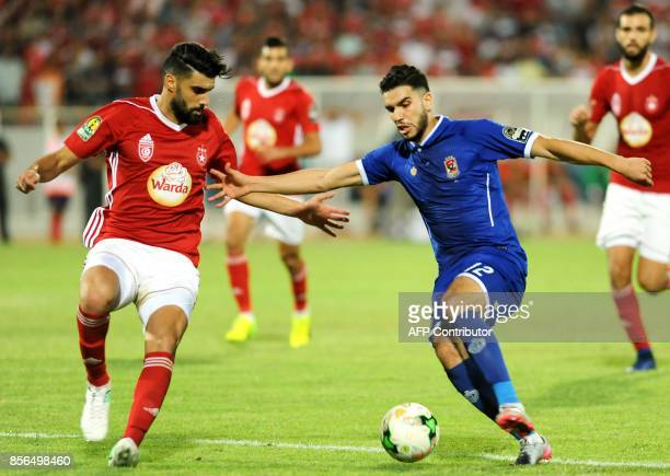Egypt's AlAhly club forward Waled Azaro vies for the ball against Etoile du Sahel's forward Amine Ben Amor during the CAF Champions League semifinal...