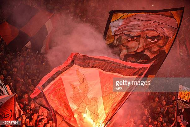 Egypt's AlAhly fans chant slogans in support of their team during their African Super cup final football match against Tunisia's Club Sportif Sfaxien...