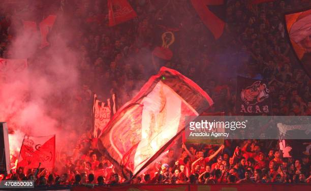 Egypt's AlAhly fans cheer and chants slogans during the CAF Super Cup final football match between Tunisia's Sfaxien and Egypt's AlAhly in Cairo...