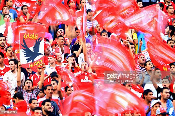 Egypt's AlAhly fans cheer for their team before the start of their African Champions League third round second leg football match against Libya's...