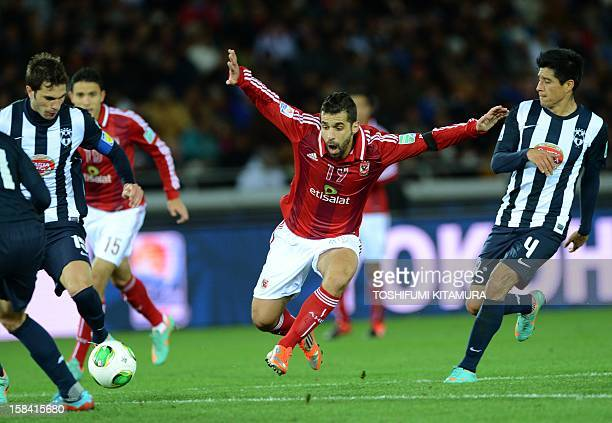 Egypt's AlAhly forward Abdallah Said appeals among Mexico's Monterrey captain and defender Jose Maria Basanta and defender Ricardo Osorio during...