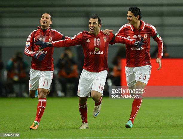 Egypt's AlAhly forward Abdallah Said is is congratulated by his teammates Walid Soliman and Mohamed Nagieb after his goal against Japan's San Frecce...