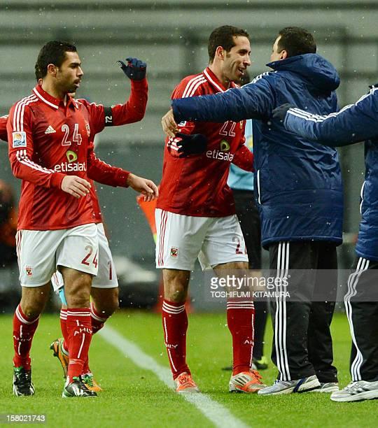 Egypt's AlAhly forward Mohamed Aboutrika celebrates his goal with head coach Hossam ElBadry against Japan's San Frecce Hiroshima during their 2012...