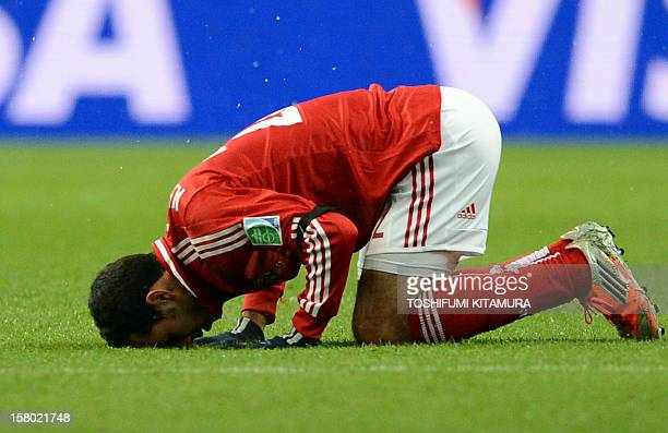 Egypt's AlAhly forward Mohamed Aboutrika prays to celebrate his goal against Japan's San Frecce Hiroshima during their 2012 Club World Cup...