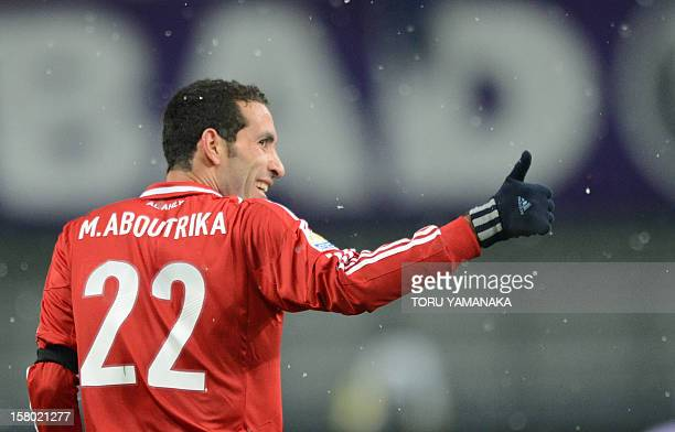 Egypt's AlAhly forward Mohamed Aboutrika reacts with joy after scoring a goal against Japan's San Frecce Hiroshima during their 2012 Club World Cup...