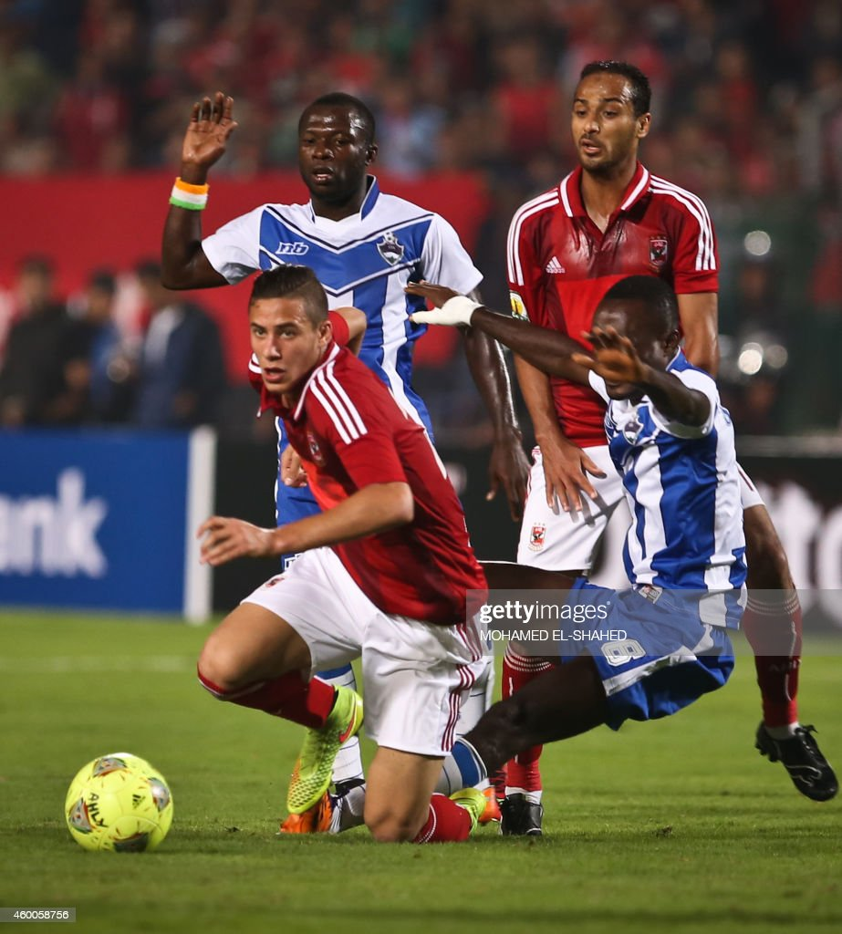 Egypt's Al-Ahly Ramadan Sobhy (C) dribble past Ivory Coast's Sewe Sport Anebil Kodjo (C-R) during the second leg of the CAF Confederation Cup final football match between Egypt's Al-Ahly and Ivory Coast's Sewe Sport at the Cairo Stadium in Cairo, on December 6, 2014.