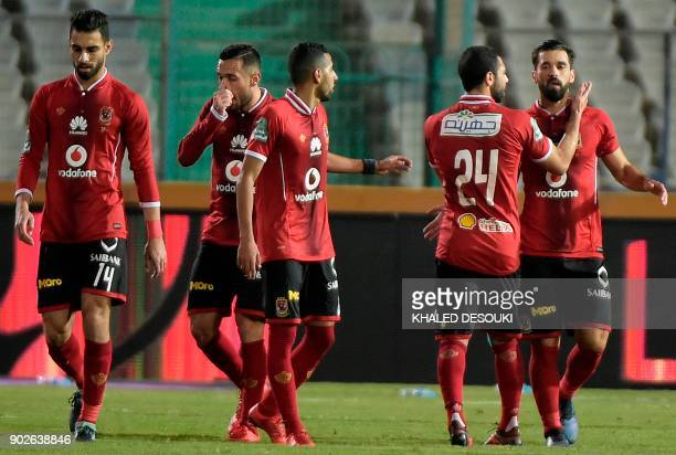 Egypts alAhly player Abdallah elSaeed celebrates with his teammates after scoring a goal during the Egyptian Premier League football match between...