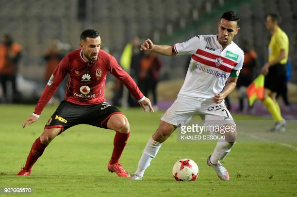 Egypts alAhly player Ali Maaloul fights for the ball against Zamalek's Hazem Immam during the the Egyptian Premier League football match between...