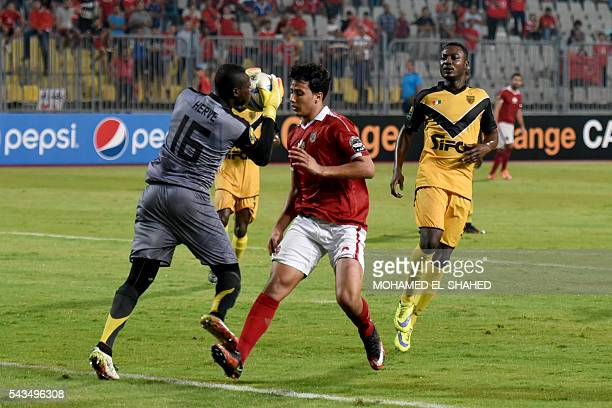 Egypt's AlAhly player Amr Gamal vies with Ivory Coast's Asec Mimosas Gol keaper Yao Kouassi during their CAF Champions League group B stage football...