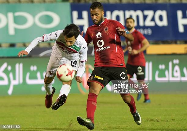 Egypts alAhly player Hossam Ashour fights for the ball against Zamalek's Ayman Hanafy during the Egyptian Premier League football match between...