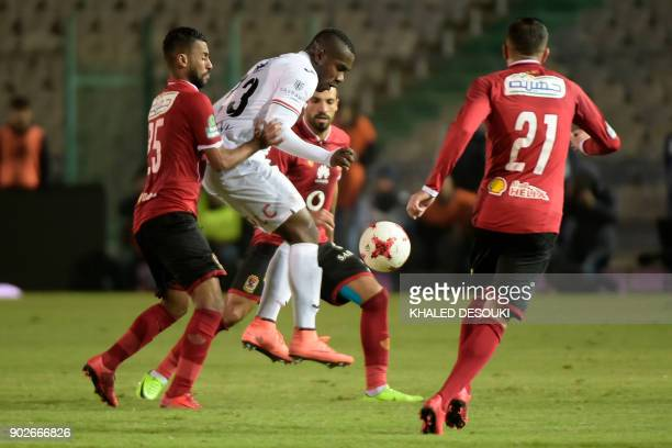 Egypts alAhly player Hossam Ashour fights for the ball against Zamalek's Kabongo Kasongo during the the Egyptian Premier League football match...