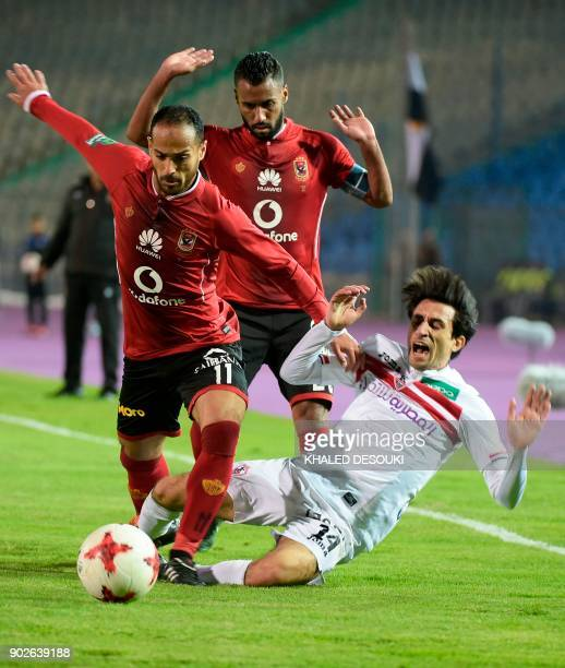 Egypts alAhly player Waled Suleiman and Hossam Ashour fight for the ball against Zamalek player Ahmed Ayman Hanafiy during the Egyptian Premier...