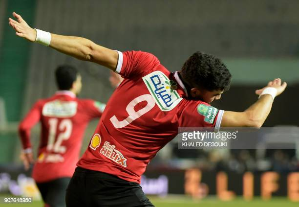 Egypts alAhly player Walid Azaro celebrates with his temmates after scoring a goal during the Egyptian Premier League football match between AlAhly...