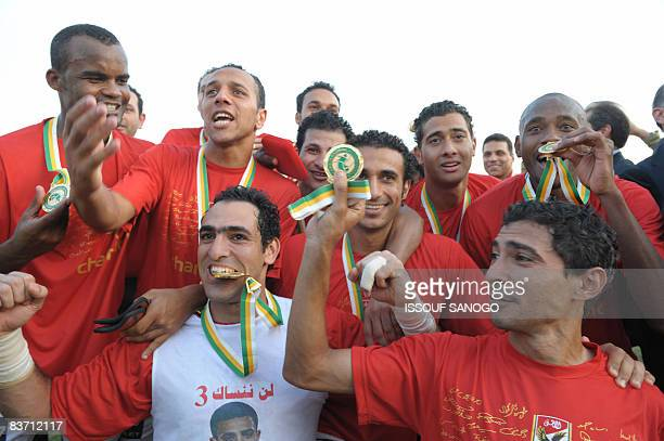 Egypt's AlAhly players celebrate winning the African Champions League trophy after drawing 22 with Cotonsport Garoua of Cameroon in the second leg of...