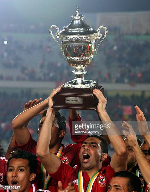 Egypt's AlAhly players celebrate with the trophy after winning the CAF Super Cup final football match against Tunisia's Sfaxien in Cairo Egypt on...