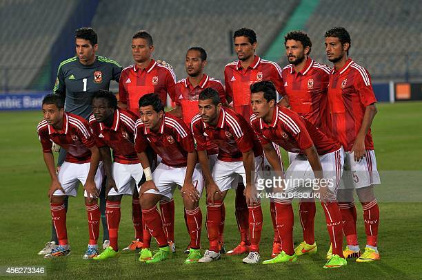Egypt's AlAhly players pose for a group picture ahead of the second leg of their CAF Confederation Cup semifinal football match against Cameroons...