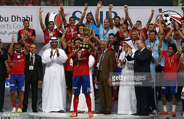 Egypt's AlAhly's players celebrate with their trophy after winning the Egypt super cup football match against Egypt's Zamalek on October 15 2015 at...