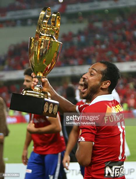 Egypt's AlAhly's Waleed Soliman celebrates with the trophy after his team won the Egypt super cup football match against Egypt's Zamalek on October...