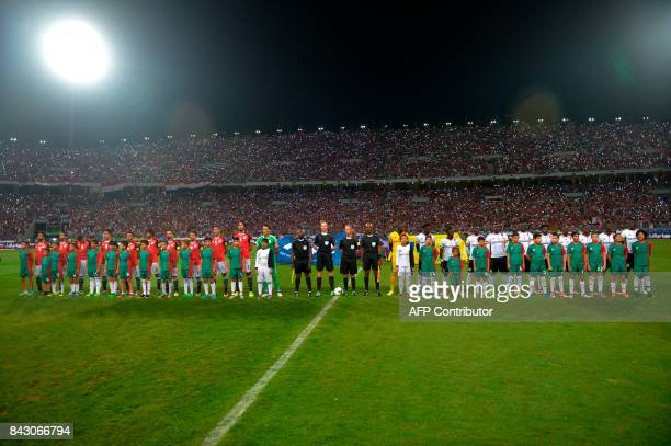 Egypts and Ugandas players pose for picture prior to the start of the FIFA World Cup 2018 qualification football match between Egypt and Uganda at...