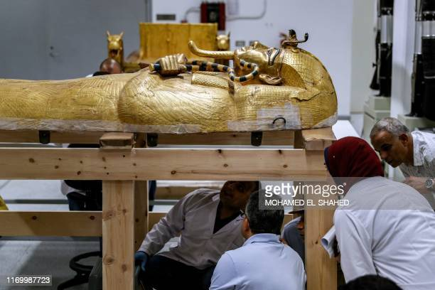 Egypt's Antiquities Minister Khaled el-Anani takes a look at the restoration process of the golden sarcophagus of the ancient Egyptian Pharaoh...