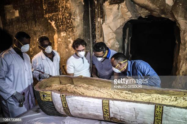 Egypt's Antiquities Minister Khaled elEnany and Mostafa Waziri the Secretary General of the Supreme Council of Antiquities inspect an intact...