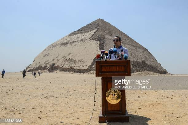 Egypt's Antiquities Minister Khaled ElEnany speaks in front of the Bent Pyramid of Sneferu during an inaugural ceremony of the pyramid and its...