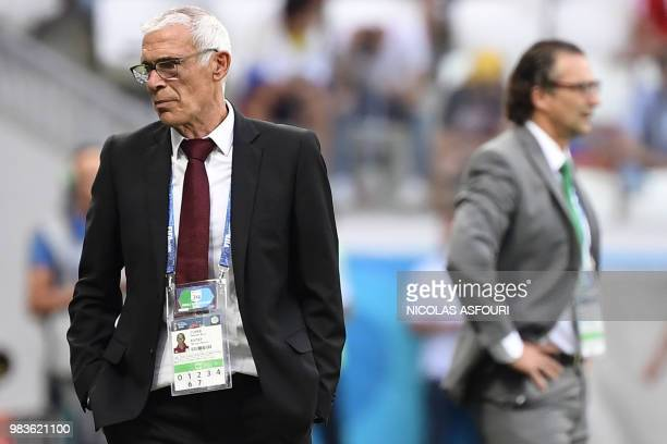 Egypt's Argentine coach Hector Raul Cuper stands near Saudi Arabia's Argentineborn Spanish coach Juan Antonio Pizzi during the Russia 2018 World Cup...