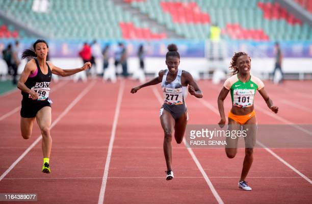 Egypt's Basant Hmeida Gambia's Gina Bass and Ivory Cost's MarieJosee Ta Lou compete during the 100m Women's Final at the 12th edition of the African...