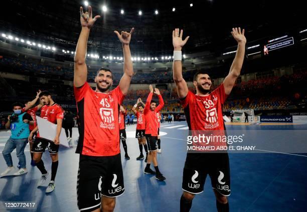 Egypt's centre back Seif Mohamed Elderaa and Egypt's left back Yehia Elderaa celebrate their win during the 2021 World Men's Handball Championship...