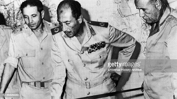 Egypt's chief of staff Saad elShazly President Anwar Sadat and minister of war' Ismail Ali review battlefield developments in the 1973 ArabIsraeli War