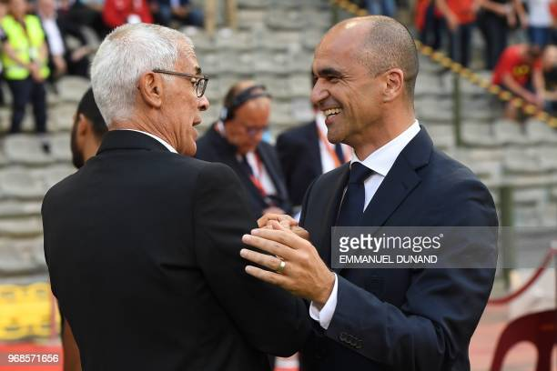 Egypt's coach Hector Raul Cuper and Belgium's coach Roberto Martinez speak and laugh prior to the international friendly football match between...