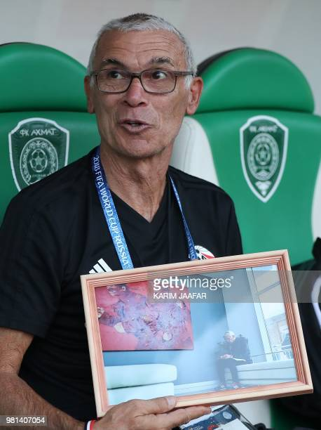 Egypt's coach Hector Raul Cuper poses with a picture during a training session at the Akhmat Arena stadium in Grozny, on June 22, 2018 during the...